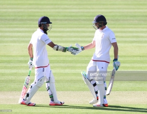 LONDON, ENGLAND - MAY 21: Moeen Ali and Jos Buttler during the England v New Zealand 1st Investec Test match, day one at Lords Cricket Ground, on May 21, 2015 in London, England.  (Photo by Mitchell Gunn/Getty Images) *** Local Caption ***Moeen Ali,Jos Buttler